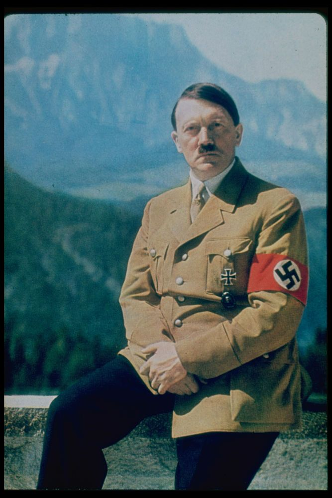 How did Adolf Hitlers Upbringing and characteristics bring him into power?