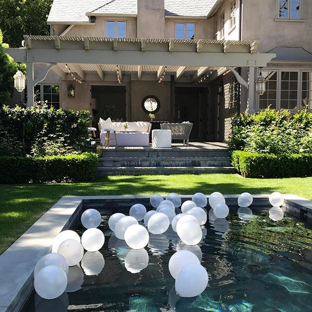 I Love The Simplicity Of These White Balloons Floating In The Pool