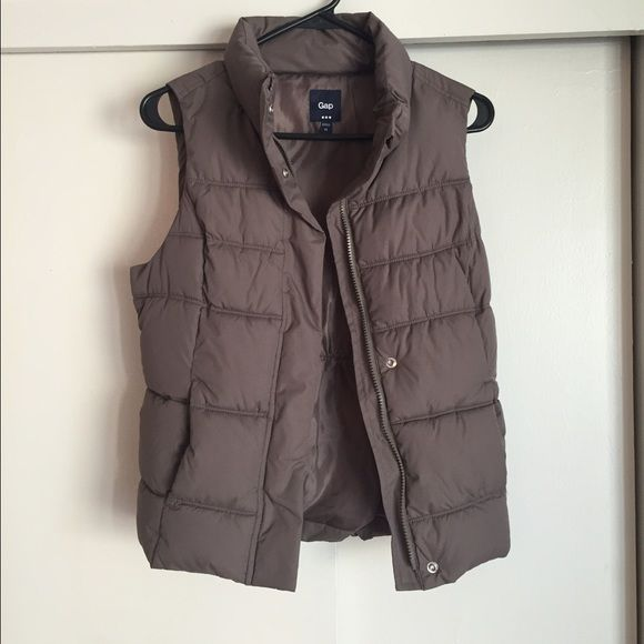 Taupe Gap Factory puffer vest Taupe Gap Factory puffer vest. Only worn a couple of times and in excellent condition. Size XS and firs TTS. Would likely fit a size Small as well. GAP Jackets & Coats Vests