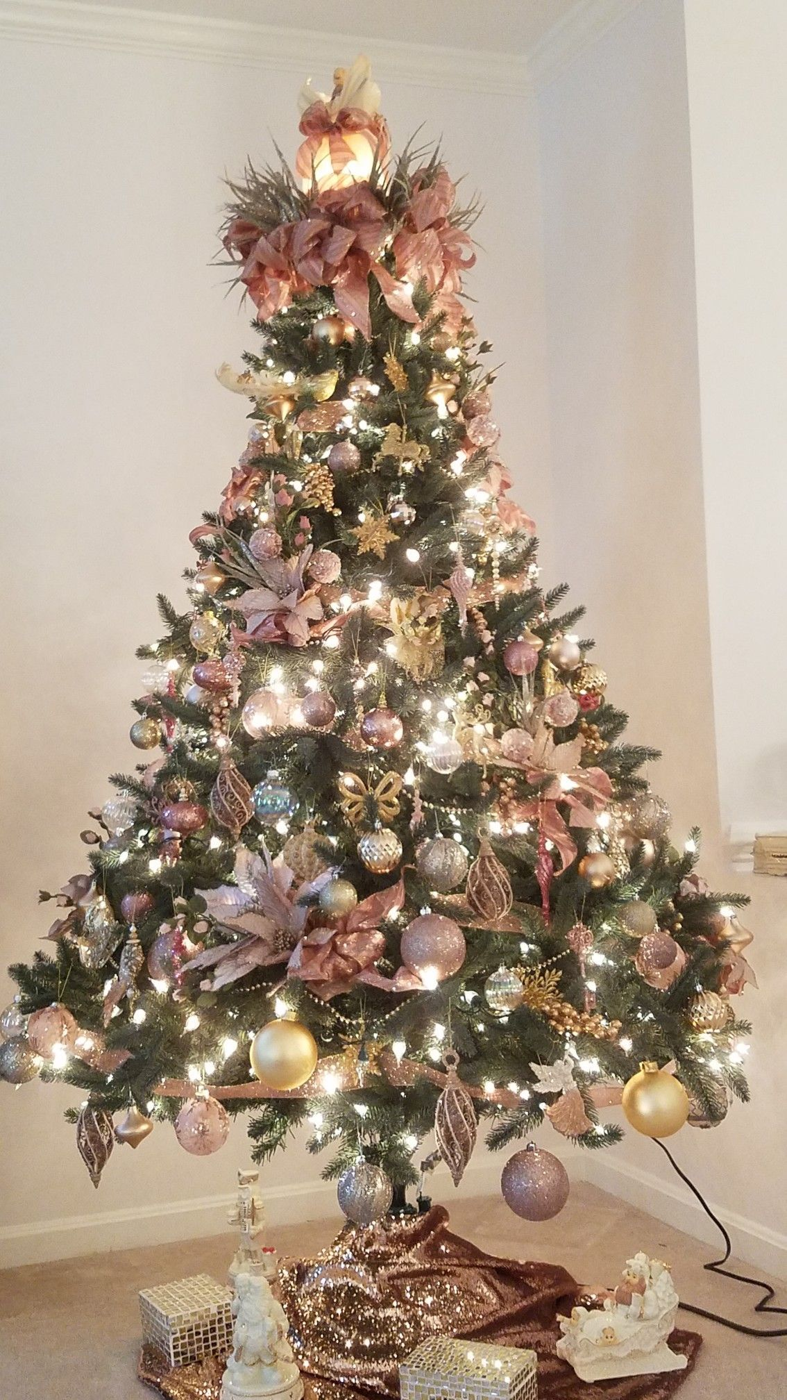 A Christmas Tree Decorated In Pink And Gold Gold Christmas Decorations Rose Gold Christmas Tree Rose Gold Christmas