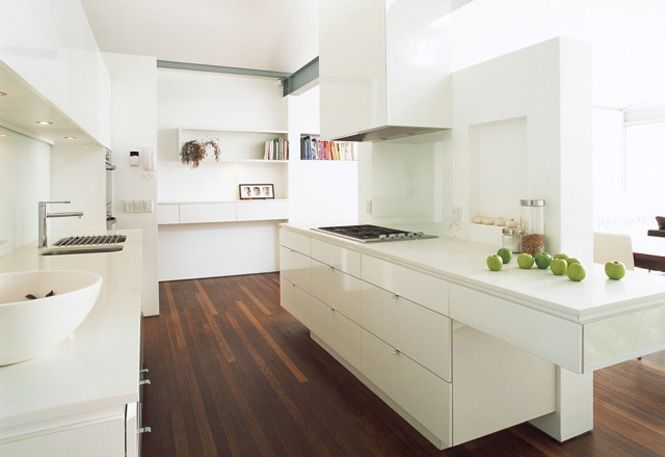 Modern kitchen in neutral tones paired with a wood look flooringI