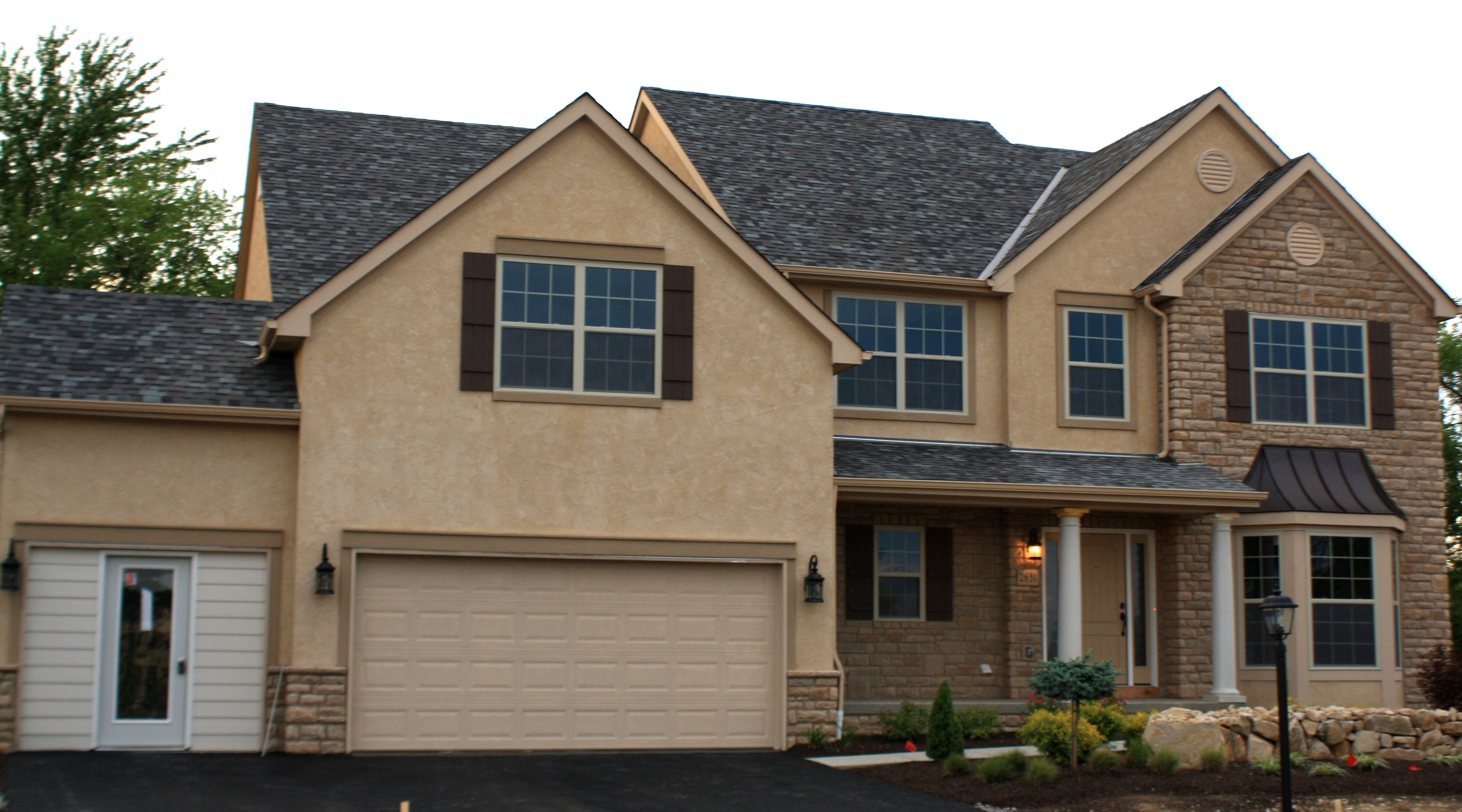 The hearth room with a stone fireplace is a must see in this Trinity Custom Home BIA home