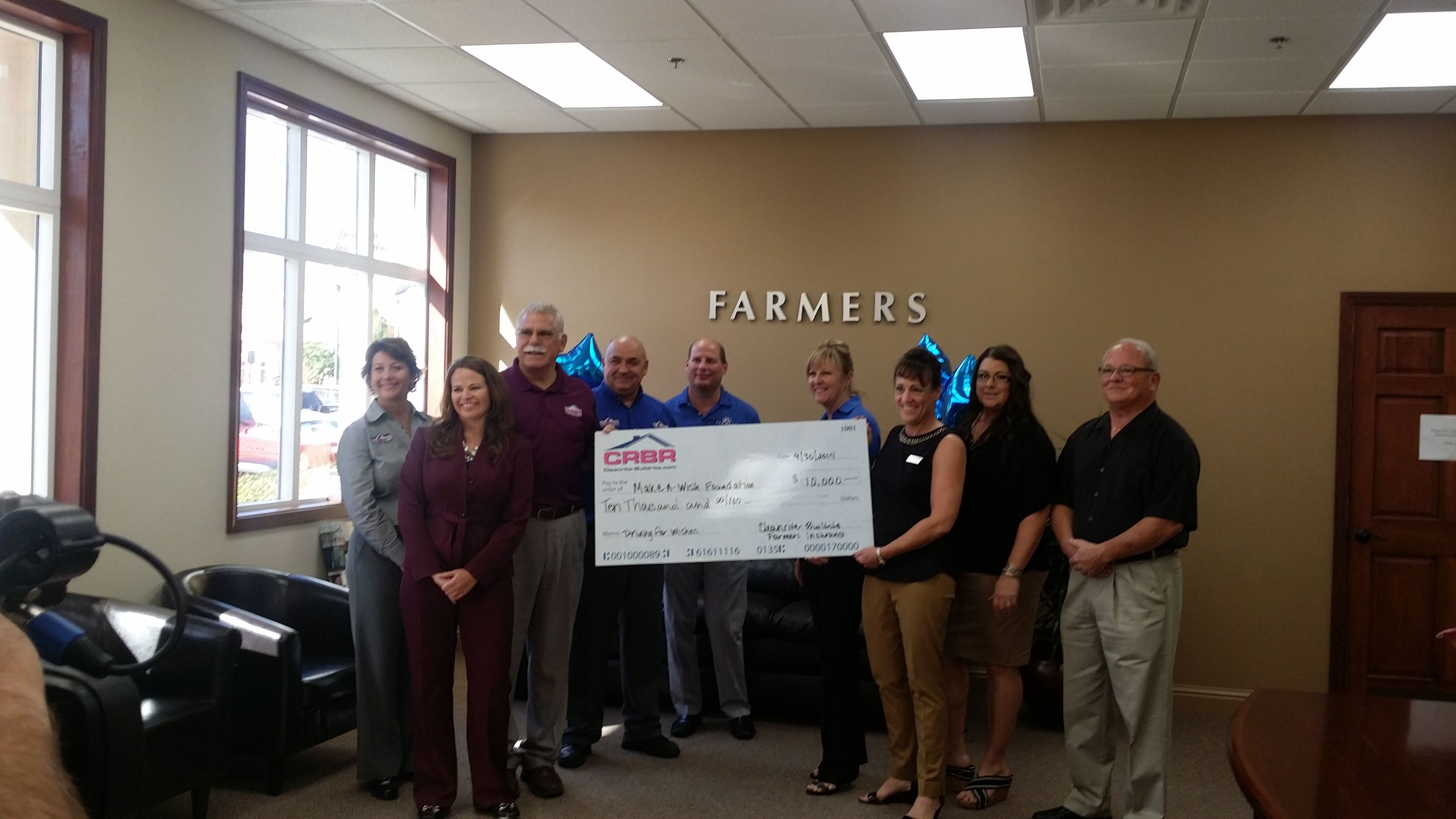 Farmers Insurance and CRBR donation to MakeAWish