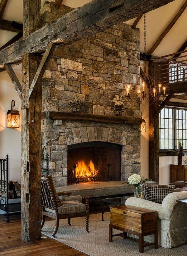 Fireplace in a stone barn addition by Crisp Architects Home Decor