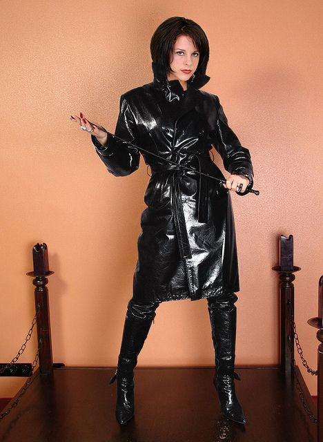 Beautiful Woman In Leather And Whip Rubber And Pvc
