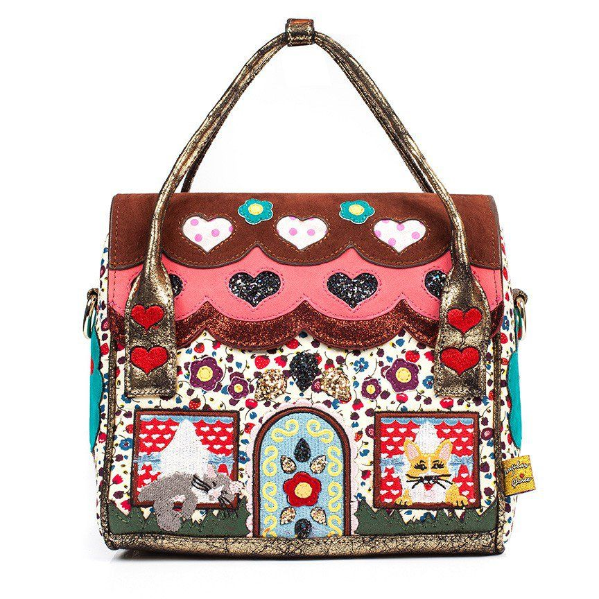 This pawfectly pretty handbag featuring printed fabric, glitter and embroidered detail is the perfect style for all you pet lovers.  Includes detachable shoulder strap.