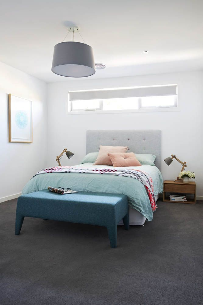 Dark grey carpet crisp white walls and a pop of colour in the