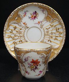 Exquisite ~ Antique ~ KPM Floral Demitasse Cup & Saucer ~ There are molded designs in the porcelain on both pieces ~ The set has intricate hand gilded decorations ~ There are clusters if flowers ~ Hand painted in vivid colors ~ origin Germany ~ Circa late 19th century