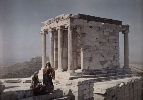 Women at Temple of Nike wear costumes of Mani and Trikeri Island. National Geographic's Greece in Color from the 1920s Photographer: Maynard Owen Williams in the 1920s
