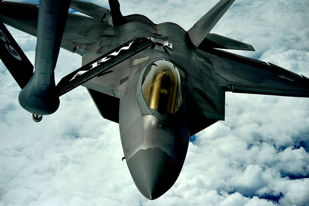 An F-22 Raptor pilot positions the aircraft to accept fuel from a KC-135 Stratotanker.