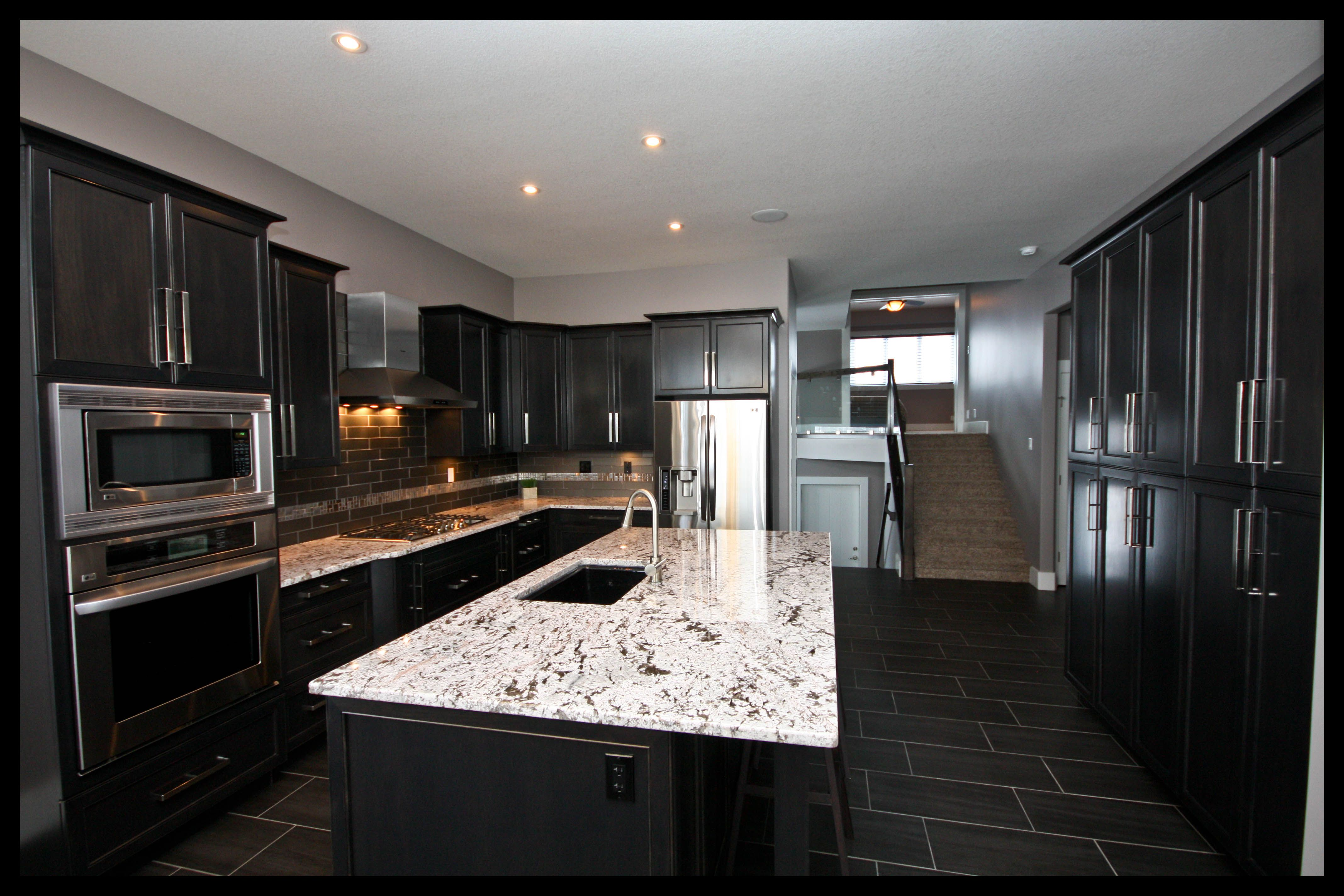 Building New Homes In Central Alberta Maple Kitchen Cabinets Maple Kitchen Maple Cabinets