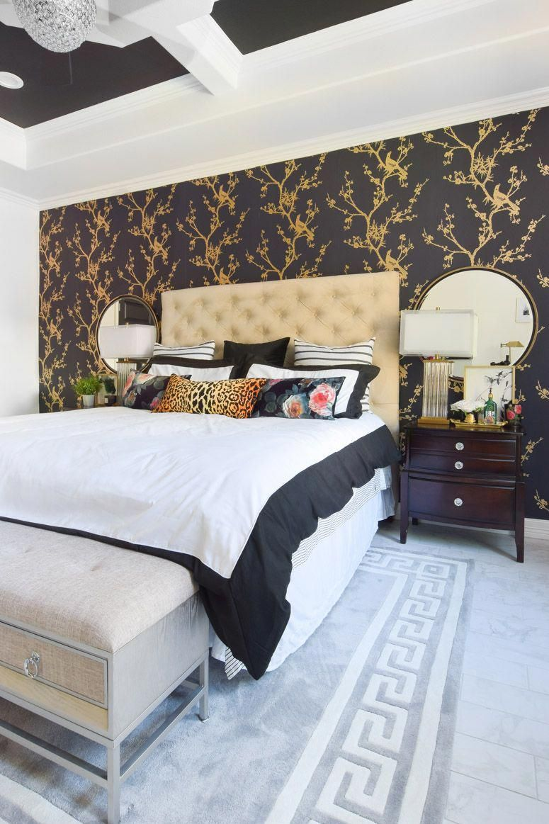Black and gold wallpaper accent wall in this chic, glam