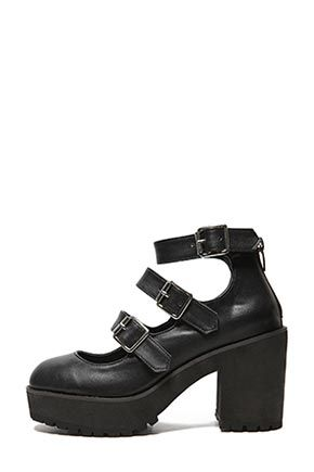 Stylenanda Triple Buckle Strap ShoesFinish a city-chic ensemble on a refined concluding note with these platform heeled shoes. This reliable, simple staple comes with a set of three buckle fastening straps, zipped back for easy wear, round toes, and cleat soles. Add a hard-edged contrast to your casual, lovely winter outfit.