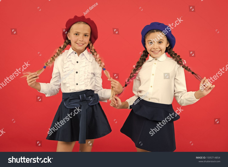 Together since school happy children in uniform International exchange school program friendship and sisterhood best friends little girls in french beret Education abroad...