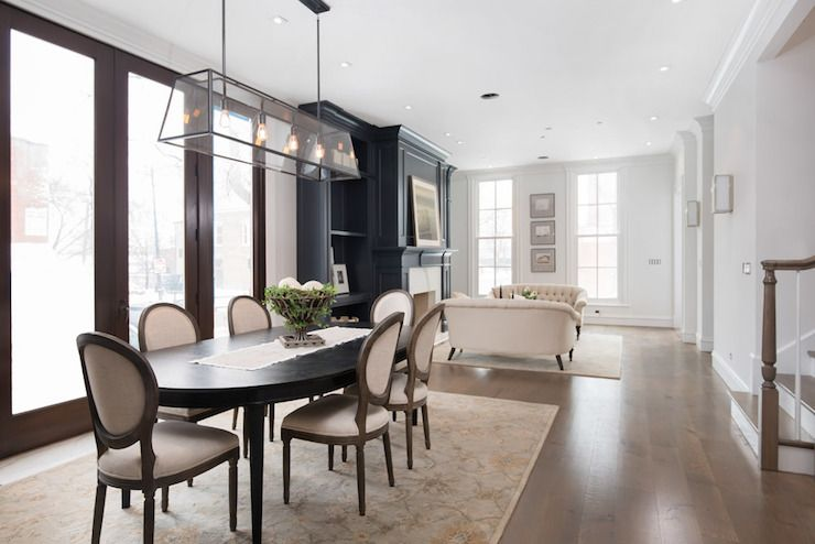Transitional Dining Room Features A Restoration Hardware Modern Filament Chandelier Hanging Over An Oval Black