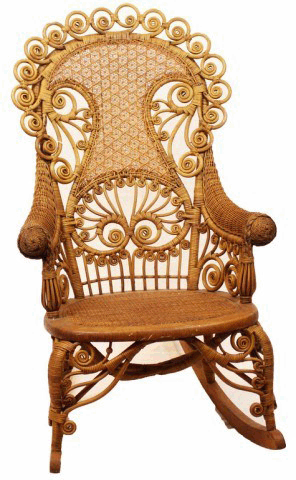 Wicker: Early Heywood-Wakefield Wicker Chair with wood frame, wicker back and arms. Curled details on chair back.  Manor Antiques.