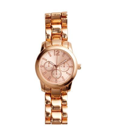 ea9a5e3df Gold metal watch with rose-colored face & luminous second hand. | H&