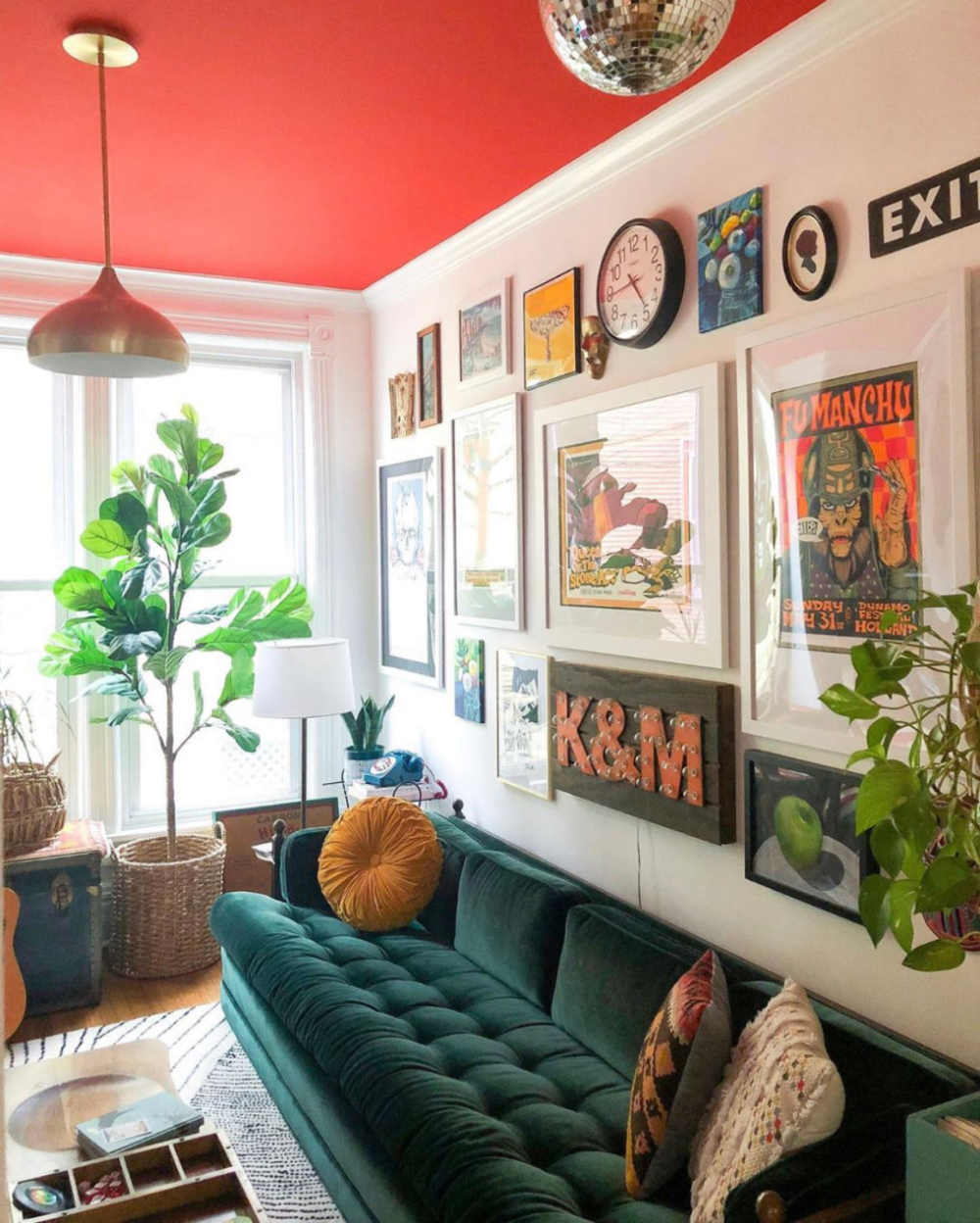 Love this colorful room with red ceiling, blue velvet sofa and eclectic gallery wall #gallerywall #velvetsofa #paintedceiling #colorfuldecor #colorlovers #eclecticdecor #vintagedecor #fiddleleaffig #bohodecor #redpaint #discoball #art #housetour
