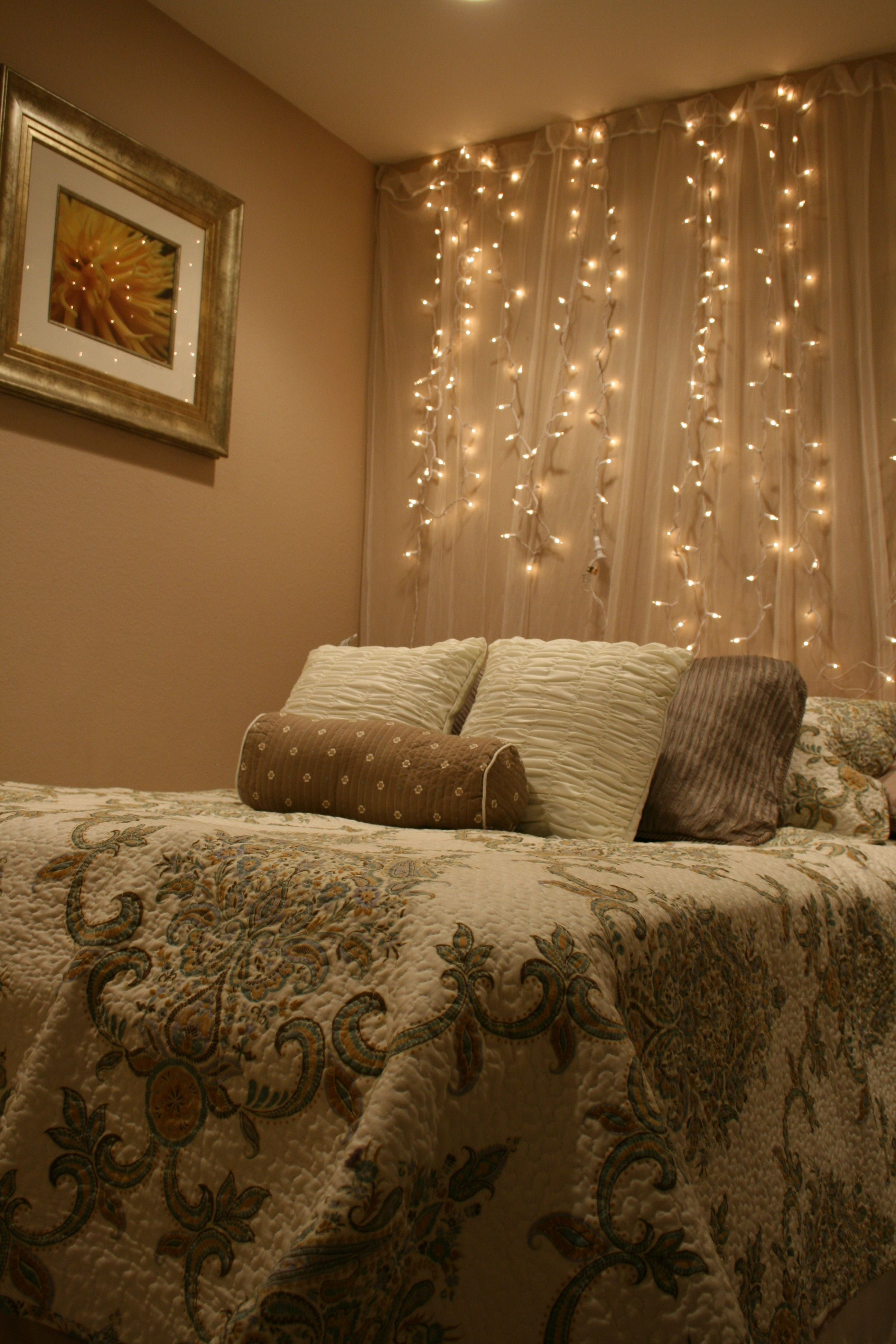 White Lights And Tulle Hung As A Backdrop Behind Your Bed Add A