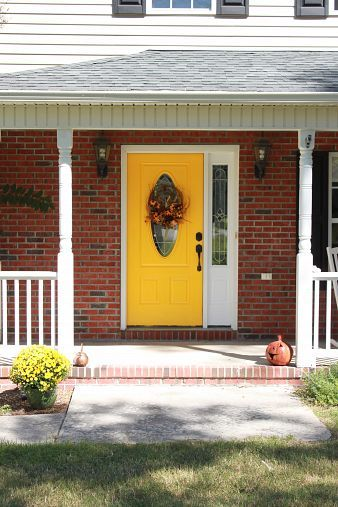 A Yellow Front Door Yellow Front Doors White Siding And