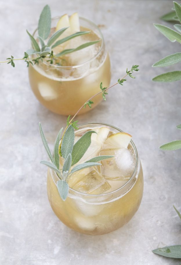 Bourbon + spiced pear cocktail | bourbon, pear puree, ginger liqueur, agave nectar, lemon juice, allspice dram, soda water, Hella Bitters Aromatic Bitters, freshly cut thyme or sage sprigs (garnish).