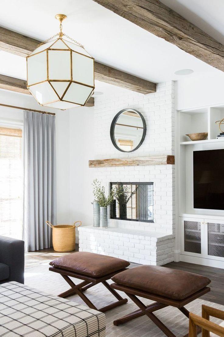 Living room remodel in a California home. Living room design and inspo. Wood beams, dark wood floors, white walls. Living room built ins. White brick fireplace.   Studio McGee Blog #livingroomfireplacedecor #whitebrickfireplace