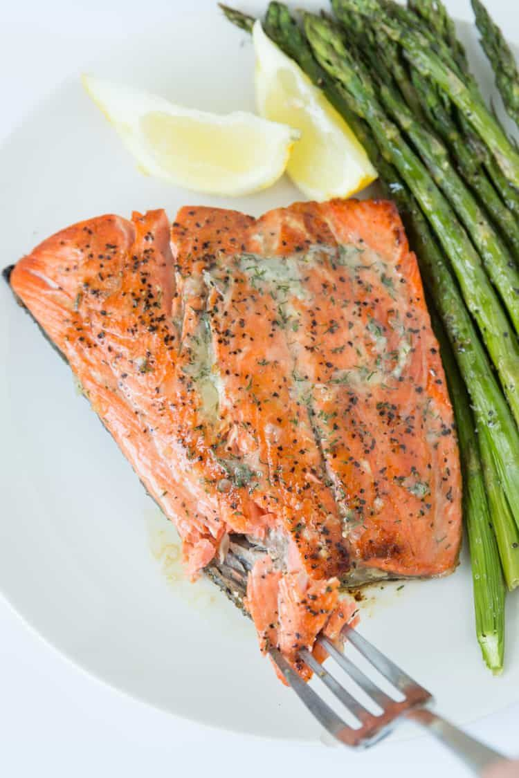 Pan seared salmon topped with a dill & garlic compound butter. 15 minute recipe! #searedsalmonrecipes