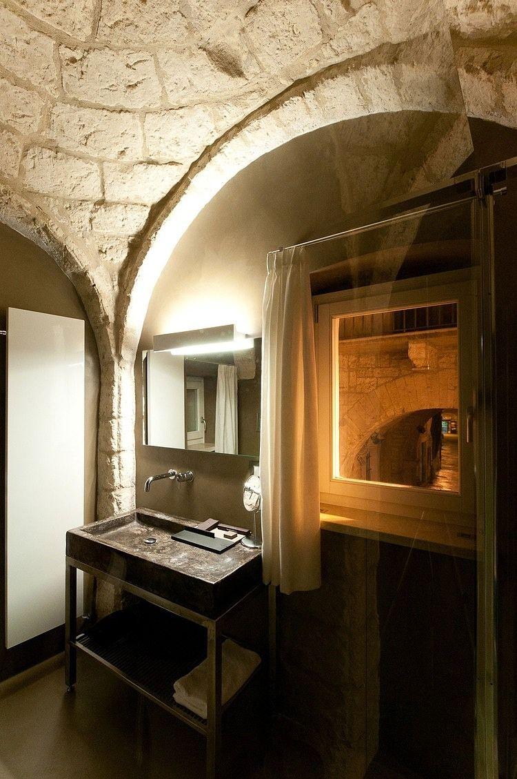 Badezimmer design rustikal caló mansion by esseelle associati studio di architettura  bath