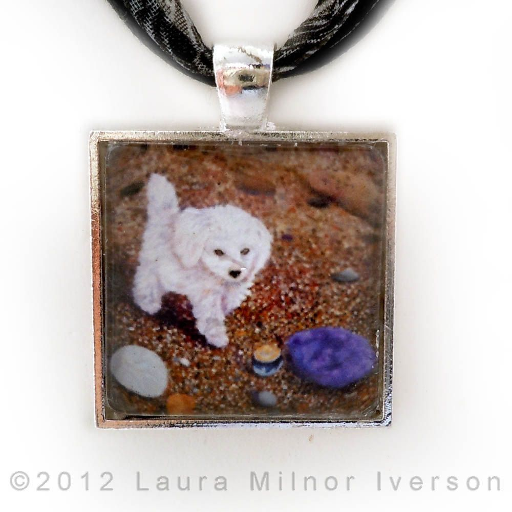 Cute pendant of a Maltipoo taking a stroll on the beach. Showcases your favorite friend while being quite stylist. $29.00, via Etsy.