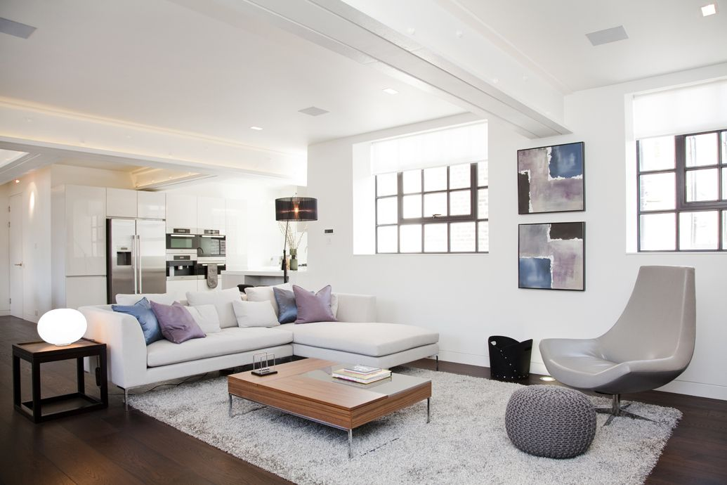 living room poufs%0A Hyde Park  LondonCream angle sofa with cushions in tones of blue and lilac   grey