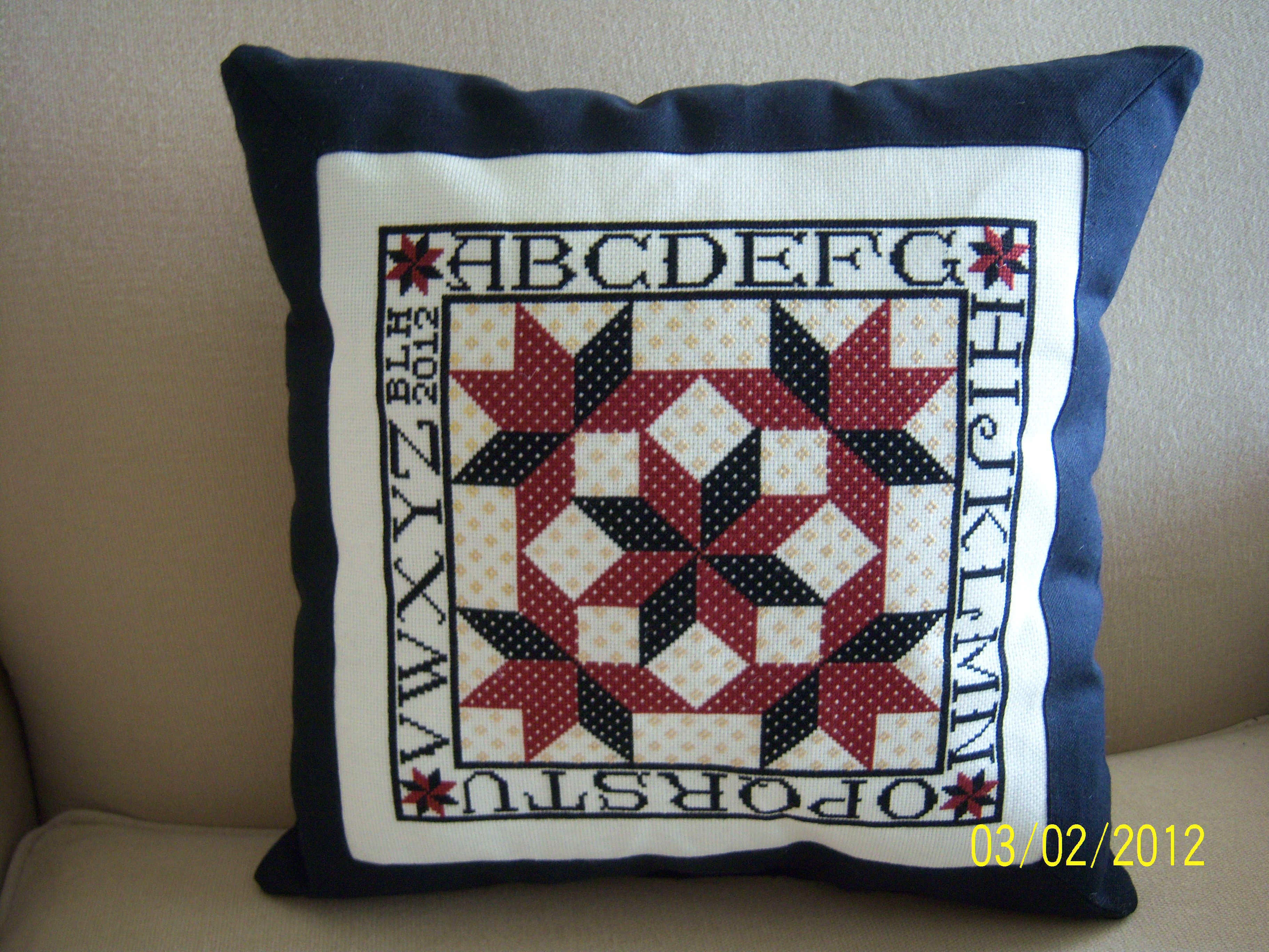 Cross Stitch pillow I just finished.  It's actually black, even though it looks navy.