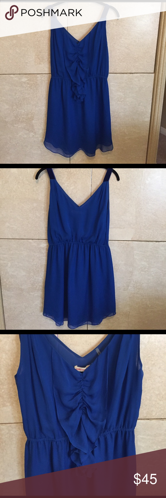 Adorable Rebecca Taylor royal blue dress size 4 Beautiful Rebecca Taylor sleeveless royal blue dress in size 4. Ruffle down front and velvet detail on straps. Excellent condition! Flowy material and flattering silhouette. Rebecca Taylor Dresses Mini