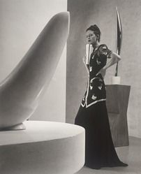 Model with Brancusi sculpture, Schiaparelli's Tunic Dress, Museum of Modern Art, photo by Louise Dahl-Wolfe
