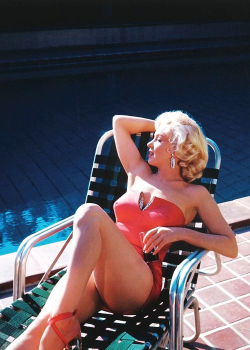 """Marilyn Monroe -during the filming of """"How to Marry a Millionaire"""", Marilyn posed for publicity shots at former silent screen star turned photographer Harold Lloyd's estate, Greenacres in Los Angeles, California. (1953)"""