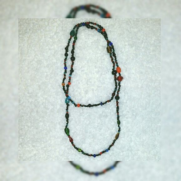 OH, The Possibilites! Wear this stunning long multicolor beaded chain as a single super long necklace or doubled for a shorter look; as a chunky beaded bracelet, knotted, or even as a headband when you don't feel like blowing out your bangs! Jewelry Necklaces