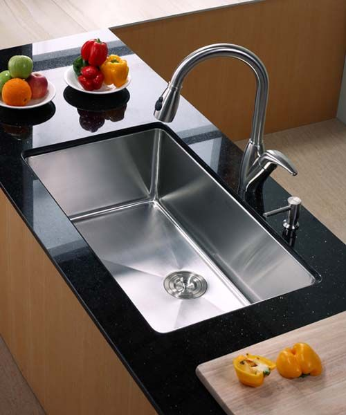 Black Counter With Fruit And Peppers Surrounding A Deep Single