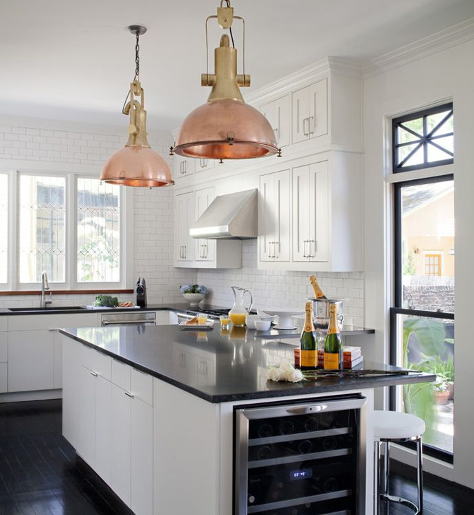 black and white kitchen with industrial copper & brass pendants