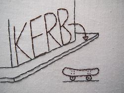 DAY TWO HUNDRED AND NINETY FOURkerb (British English) curb (US English) noun 1. an edge between a sidewalk/pavement and a roadway consisting of a line of curbstones  <2 strands on cotton> BUY THIS PIECE HERE! http://emmaruthhughesembroidery.tictail.com/