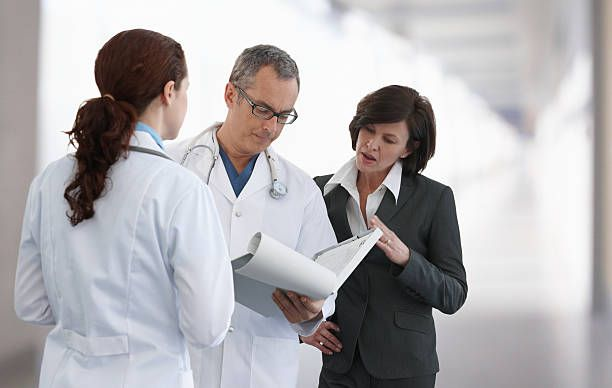 Hospital Staff Reviewing Paperwork Healthcare Stock Imagery