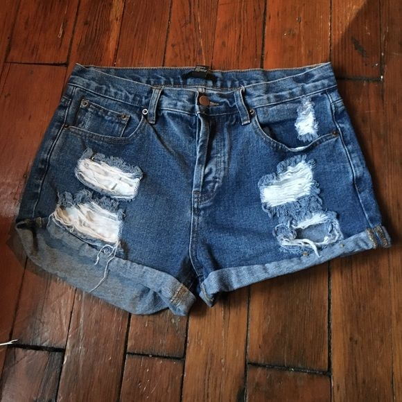High waisted dark  jean shorts with rips❤️ One of my favorite high waisted Jean shorts from forever 21!! Don't fit me anymore and are in PERFECT condition! Size 29 and fit great. No stains. Forever 21 Shorts Jean Shorts
