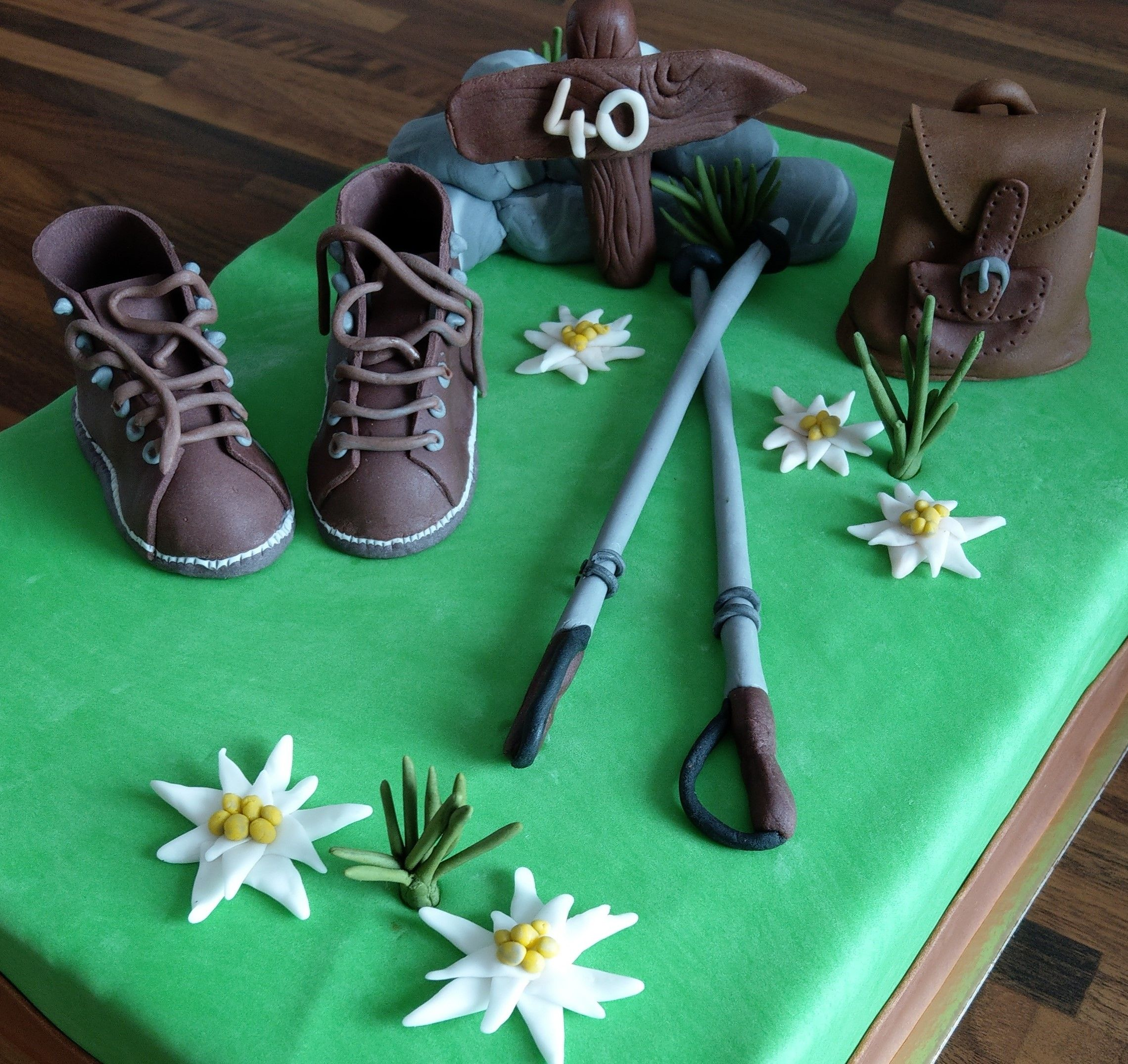 Mountaineer cake topper | Sugar flowers, Cake toppers, Cake