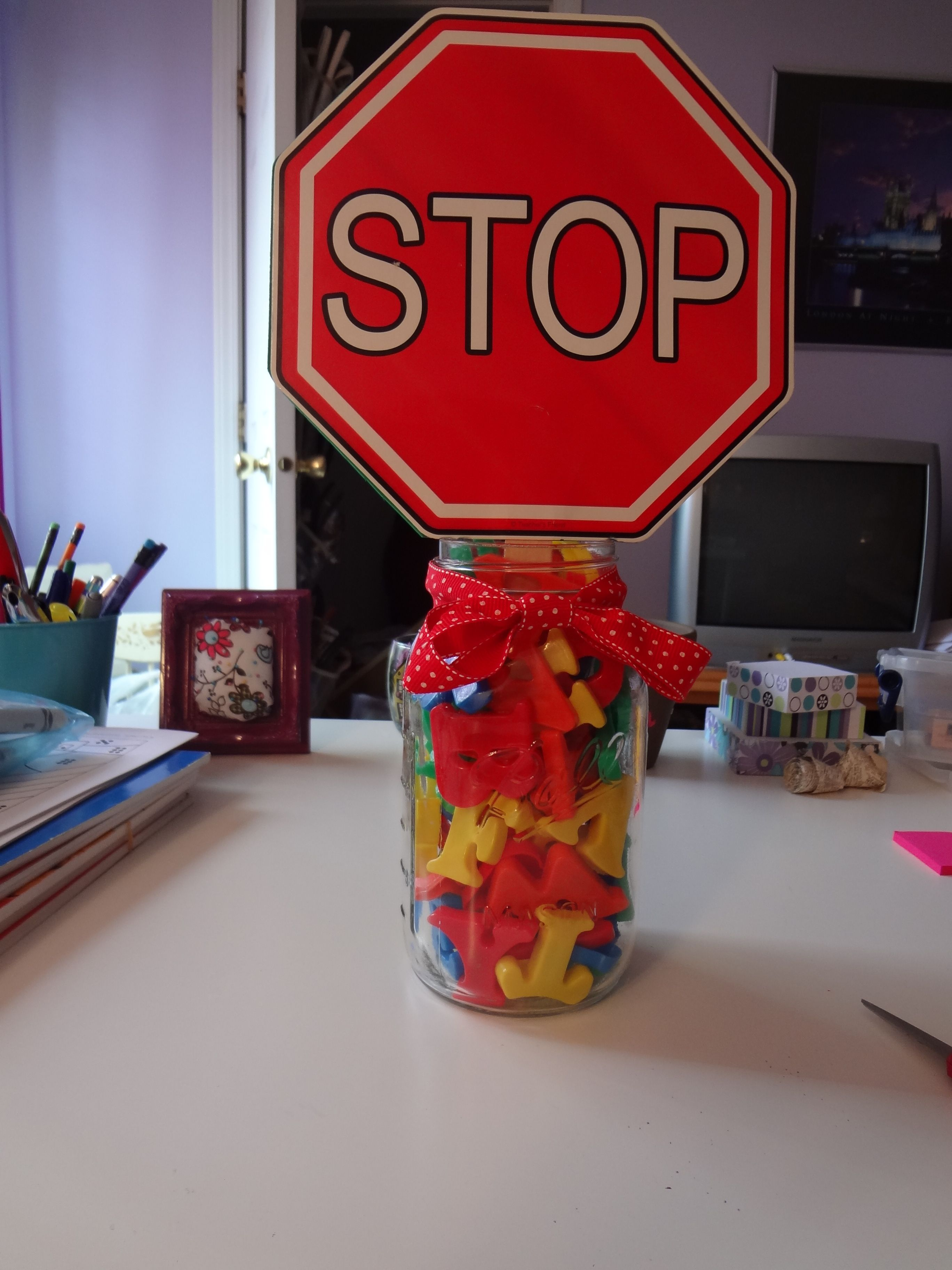 Stop sign for school letters in a ball jar