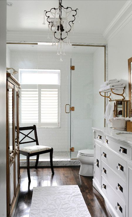 Stunning bathroom features walls painted benjamin moore white cloud highlighting  glass shower tiled in subway also