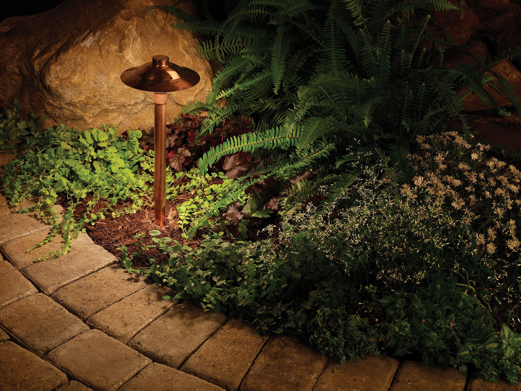 our classically designed copper path light graces this tumbled paver