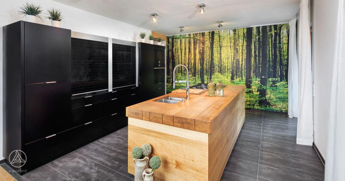 Imposante Kücheninsel ÖkohausAnbau Fasel von Baufritz