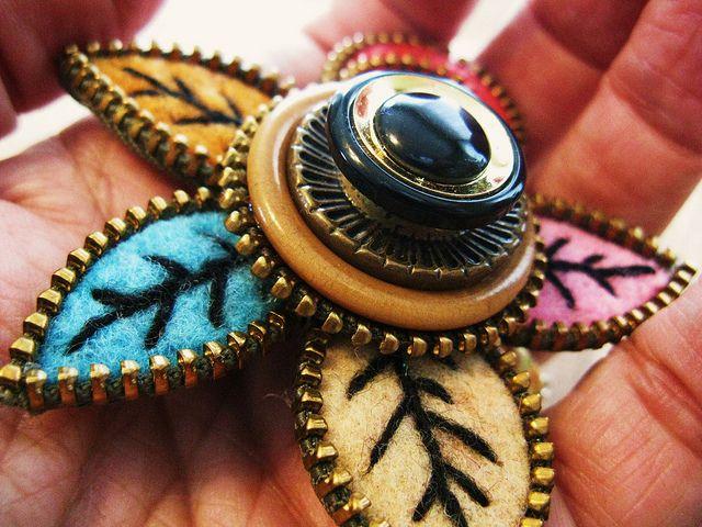 Stacked buttons, felt, & zippers