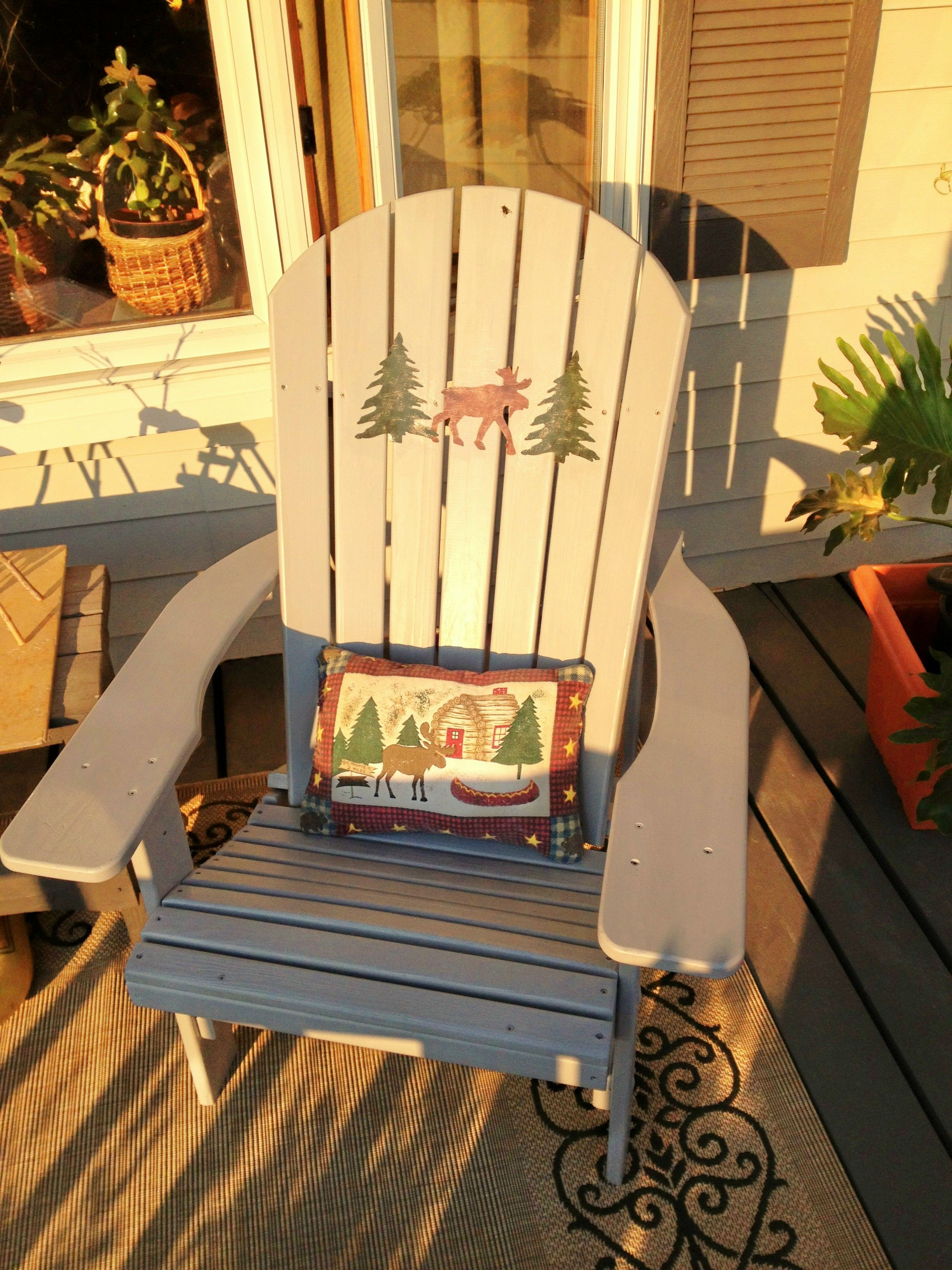 I painted an unfinished adirondack chair and added wallpaper decals