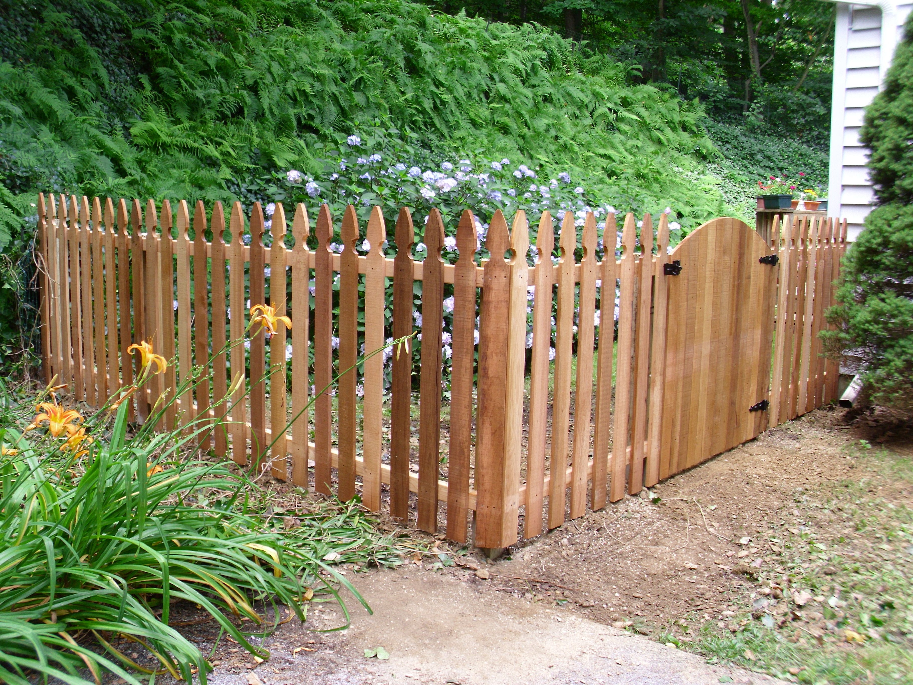 French Gothic top spaced picket fence with convex Solid Board gate