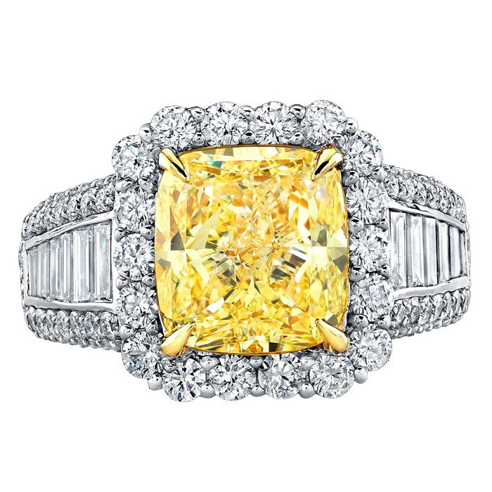 Fancy yellow diamond engagement ring with baguette diamond band.