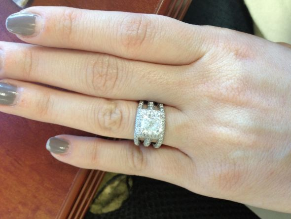 Engagement ring with multiple wedding bands